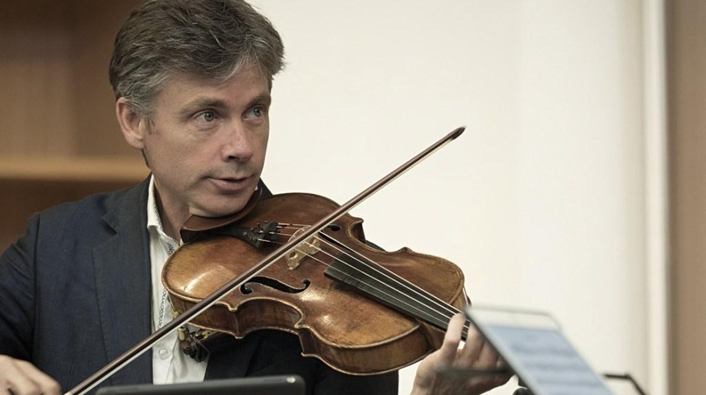 Man playing a viola (head and shoulders shot)